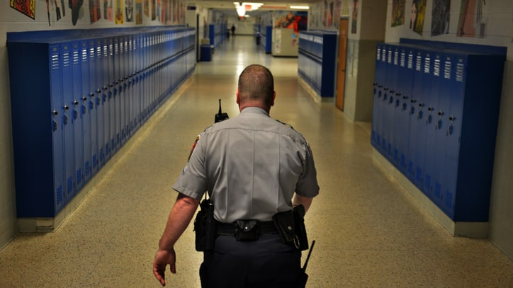 Why Are Police Using Military-Grade Weapons in High Schools?