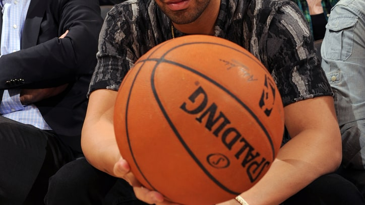 10 Plausible Reasons Drake Brought a Lint Roller to an NBA Game