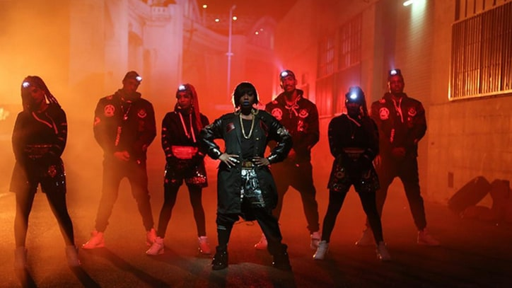 Missy Elliott, Pharrell Spin Heads in Wild, Futuristic 'WTF' Video