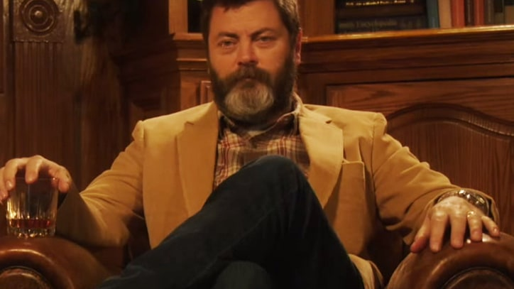 Watch Nick Offerman Drink Whiskey, Sit Silently by Fire for 45 Minutes