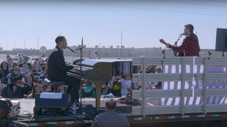 Watch John Legend, Juanes Play 'Redemption Song' Outside Detention Center