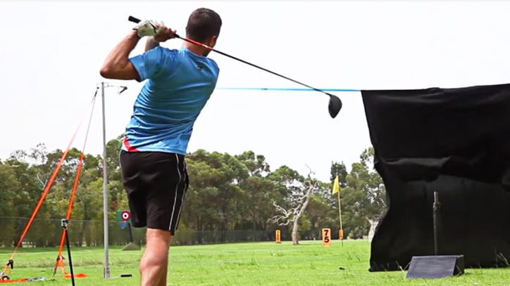 Watch Some Dudes Drive Golf Balls Into an Ax Blade