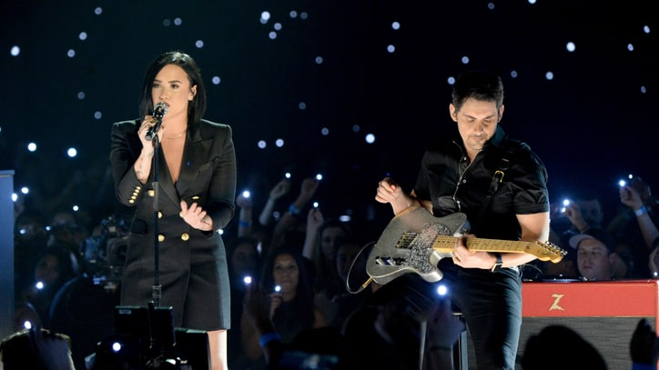 See Brad Paisley and Demi Lovato's Graceful iHeartRadio Awards Collab