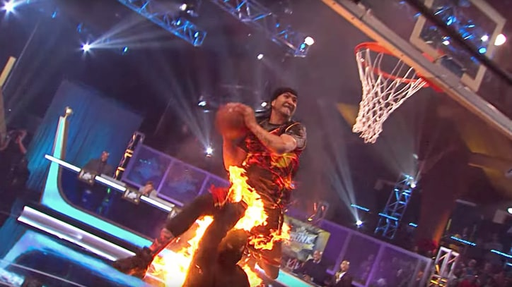 Hot Stuff: Watch a Dude Dunk Over Another Dude – Who Is On Fire