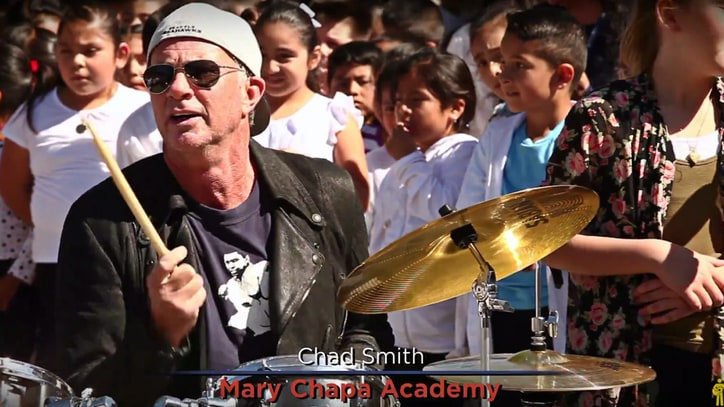 Watch Chad Smith, Jack Johnson Cover Sly Stone With Kids