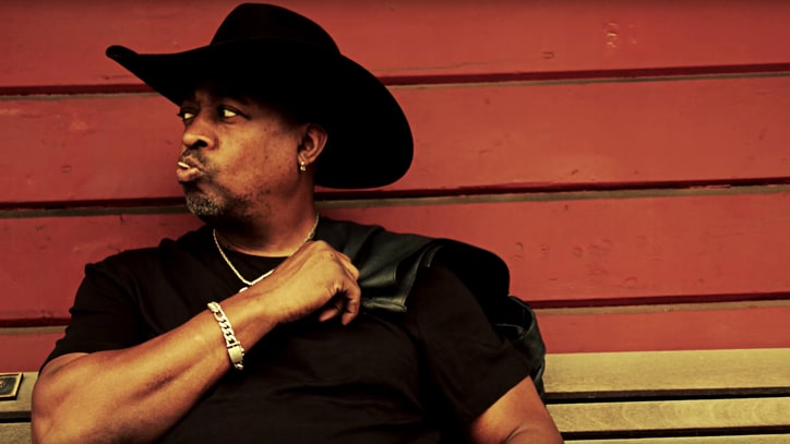 Chuck D Goes Cowboy for Public Enemy's 'Honky Tonk Rules' Video