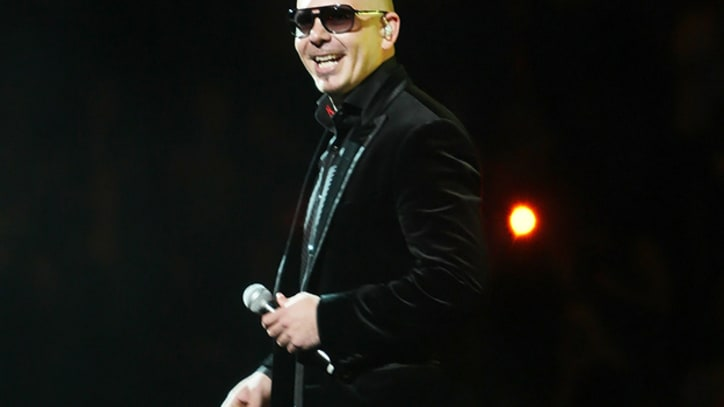 Pitbull Files Countersuit Against Lindsay Lohan
