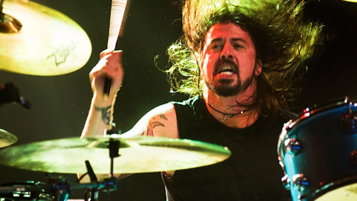 Dave Grohl Honored With 900-Pound Drumsticks by Hometown