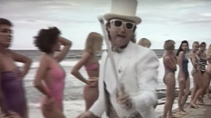 Flashback: Phil Collins Spoofs MTV in 'Don't Lose My Number' Video