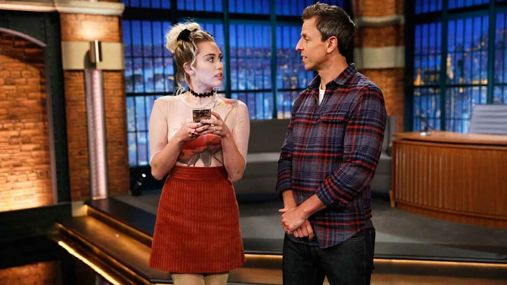 Watch Seth Meyers, Miley Cyrus Become 'Forced Friends' on 'Late Night'