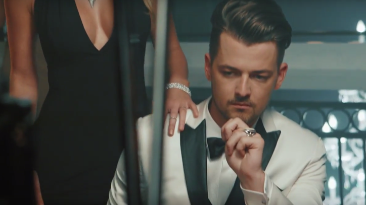 See Chase Bryant Channel James Bond in 'Room to Breathe' Video Preview