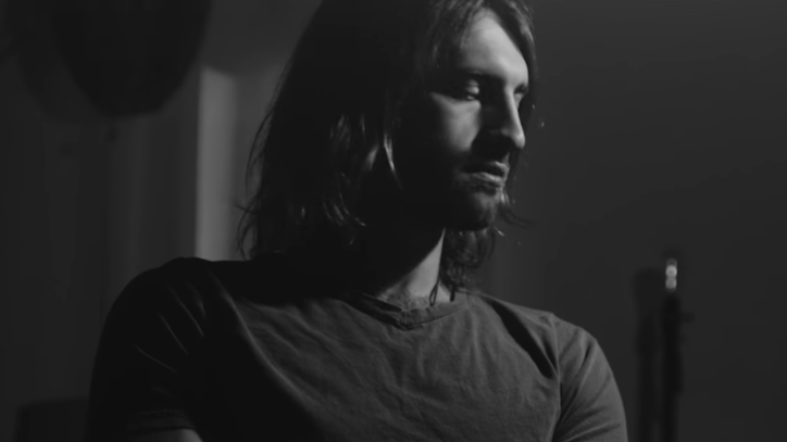 Watch Ryan Hurd's Smoldering 'Hold You Back' Video