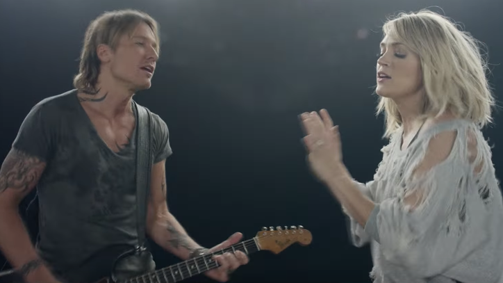 See Keith Urban, Carrie Underwood's Kinetic 'The Fighter' Video