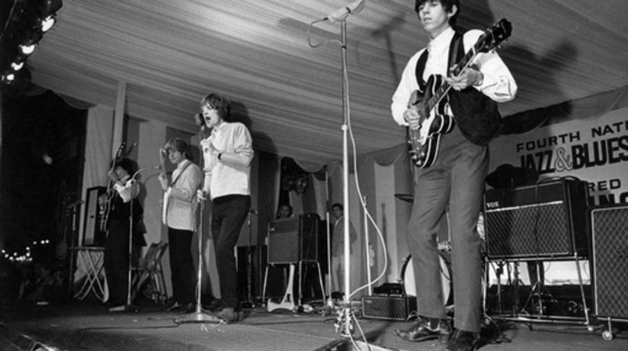 The Rolling Stones perform at the National Blues and Jazz Festival in Surrey, England in August 1964.