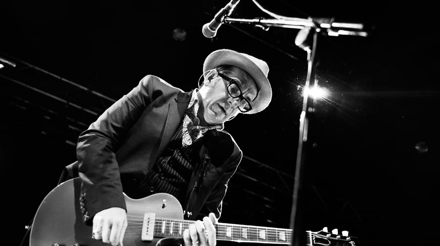 "Elvis Costello and the Roots, ""Walk Us Uptown"""