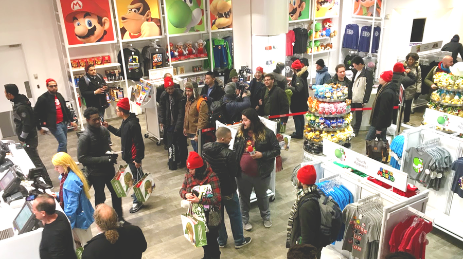 Eager fans waited patiently in line once inside the Nintendo World store, under the watchful eye of Mario