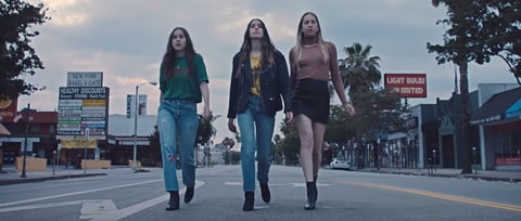 Watch Haim Dance Down L.A. Street in Joyful 'Want You Back' Video