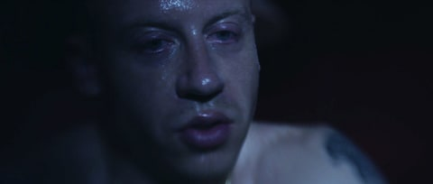 Watch Macklemore Fight Addiction Demons in Chilling 'Drug Dealer' Video