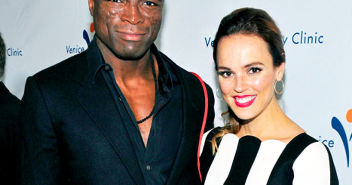 Seal steps out with power rangers actress erin cahill one year after