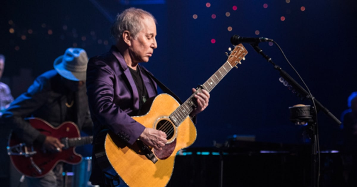 "Watch Paul Simon Deliver The News About Muhammad Ali's Death While Performing ""The Boxer"" news"