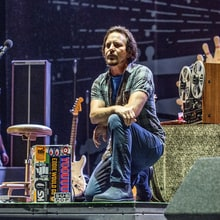 Eddie Vedder, Roger Waters, Pharrell Take Knee Onstage in Protest