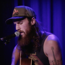 See Alex Williams' Defiant Acoustic 'Pay No Mind'