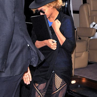 Beyonce Flashes Legs in Bizarre Fishnet Stockings