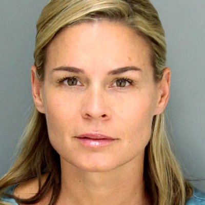 See Cat Cora's Super-Glam Mug Shot!