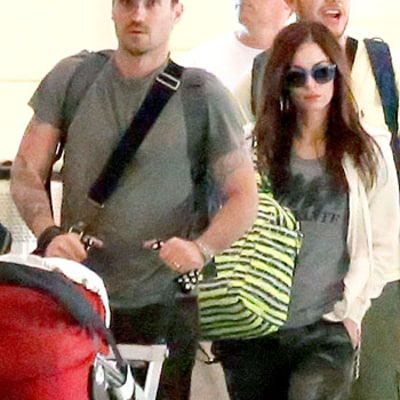 Megan Fox Shields Baby Bump With Tote