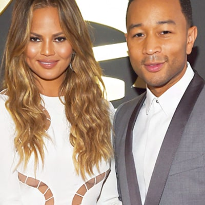 Chrissy Teigen, John Legend May or May Not Have Had Sex at the White House: Watch Her Embarrass Him in This Awkward Video from Grammys 2015 Carpet
