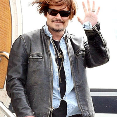 Johnny Depp Piles on Way Too Many Accessories for a Flight: See His Outrageous Airport Style