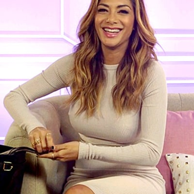 Nicole Scherzinger Tells Us: What's In My Bag? (Hint: At Least One