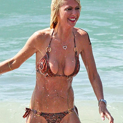 Tara Reid Romps on the Beach in Teeny-Tiny Nude Bikini: Swimsuit Pics