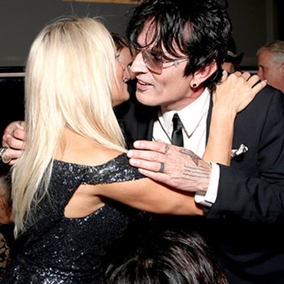 Pamela Anderson, Ex-Husband Tommy Lee Reunite at PETA Event: Photo, Video