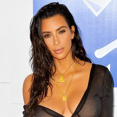 Kim Kardashian Is Reading a Book About a Near-Death Experience After Her Paris Robbery