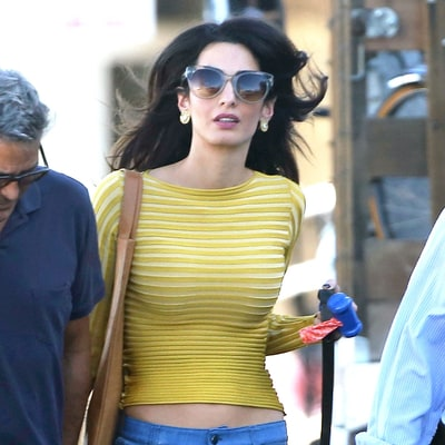 Amal Clooney Goes Full-On '70s in Floral Embroidered Jeans to Visit George on Set