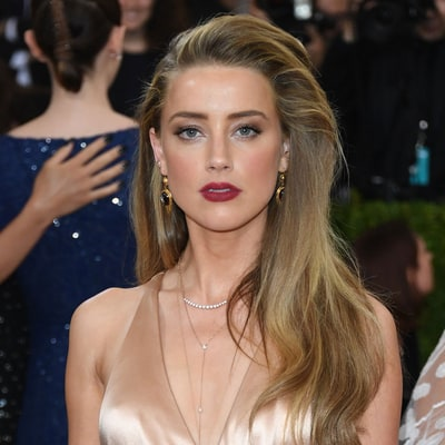 Amber Heard's Lawyer Slams Claims She's Blackmailing Johnny Depp