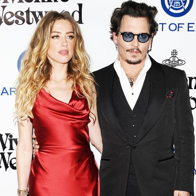 Amber Heard Calls Johnny Depp Out for Donating $7 Million Divorce Settlement to Charities, Says It Should be $14 Million