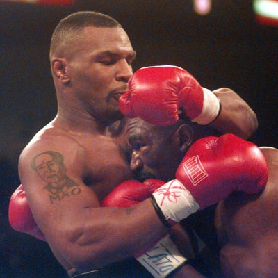 Flashback: Mike Tyson Bites Off Evander Holyfield's Ear During Match
