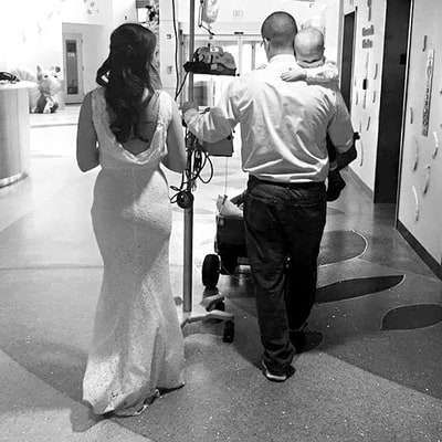 Tender Photo Captures Couple Carrying Their Cancer-Stricken Son, 2, After Hospital Wedding