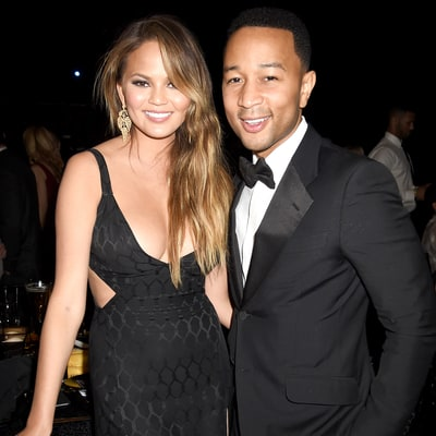 Chrissy Teigen Dresses Baby Luna as a Hotdog, Peacock for Halloween — and She's Not Impressed!