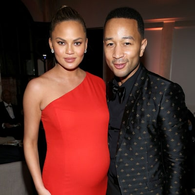 Pregnant Chrissy Teigen Sizzles in a Fitted Red Dress at the Grammys 2016 Afterparties