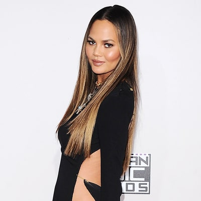 Chrissy Teigen Apologizes for Flashing Her 'Hooha' at AMAs, Thanks Laser Hair Removal Specialist