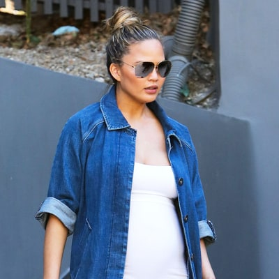 Pregnant Chrissy Teigen Pulls Off Denim Duster Coat With Ease