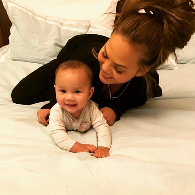 Chrissy Teigen Goes Off on Twitter Follower After Being Accused of Holding Baby Luna Wrong