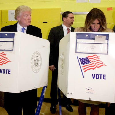 People Can't Stop LOLing Over These Photos of Donald and Eric Trump Peeking at Their Wives' Ballots