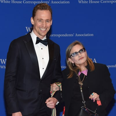 Carrie Fisher Is Escorted by Her Dog to White House Correspondents' Dinner 2016
