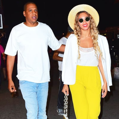 Beyonce Steps Out With Jay Z in Bright Yellow Trousers, Tiny Lemon Sticker on Her Phone