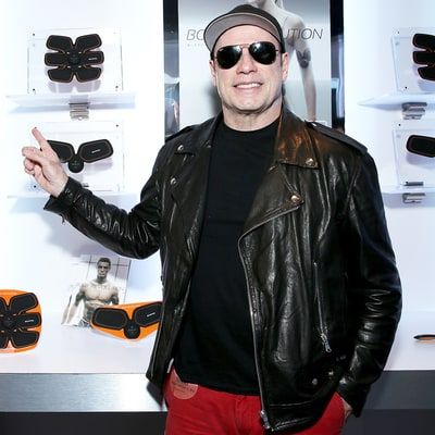 John Travolta Turns Up the Heat in Red Pants and Sunglasses Indoors