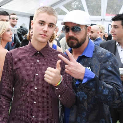 Justin Bieber Slammed by PETA for Petting Tiger at Dad's Engagement Party